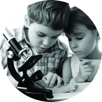 Image of two young people with a microscope