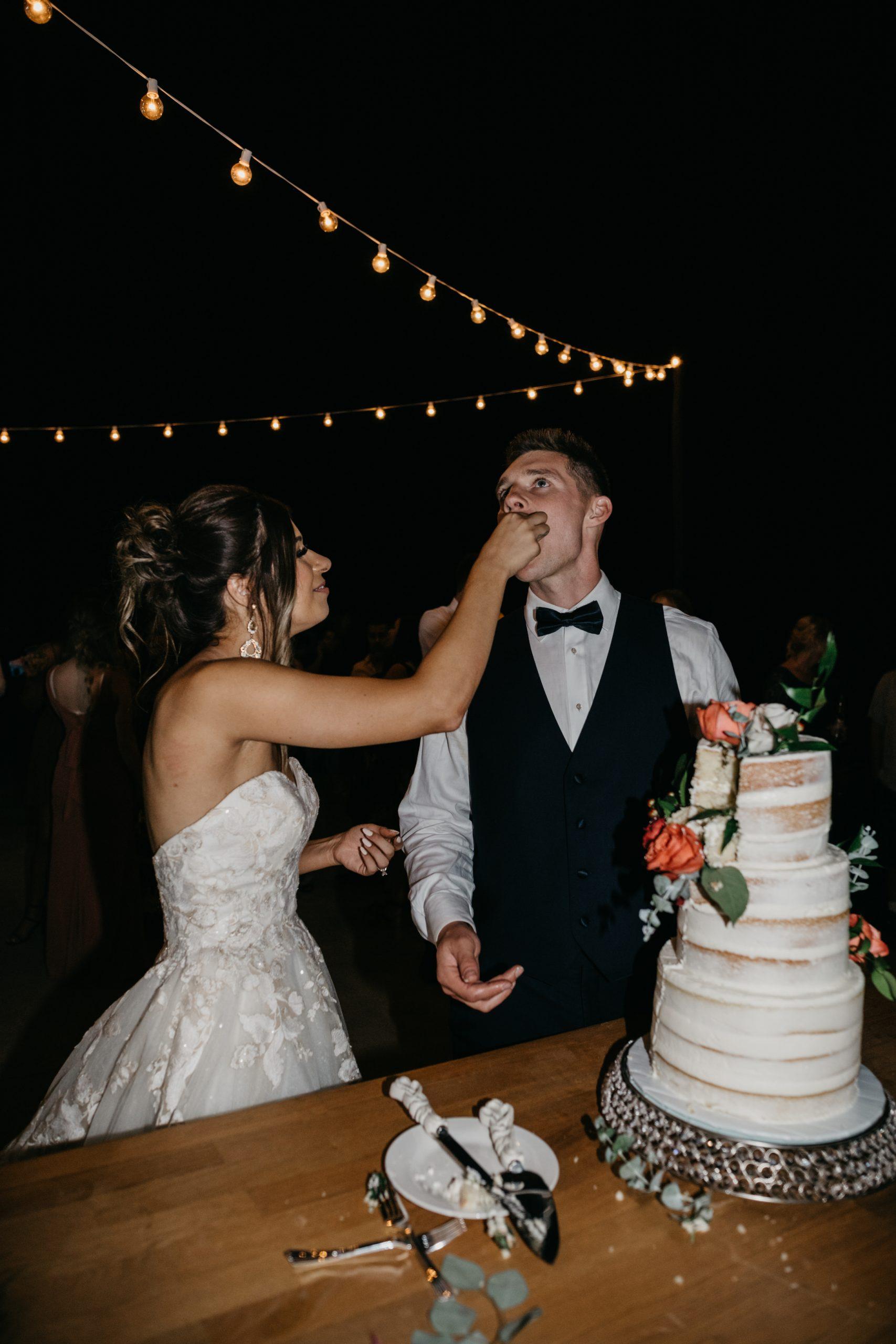 Bride and groom cut cake, image by Fatima Elreda Photo
