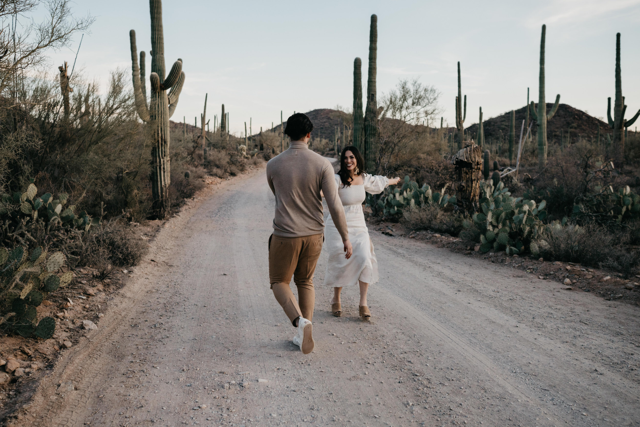 Couple dancing and running in the desert, image by Fatima Elreda Photo