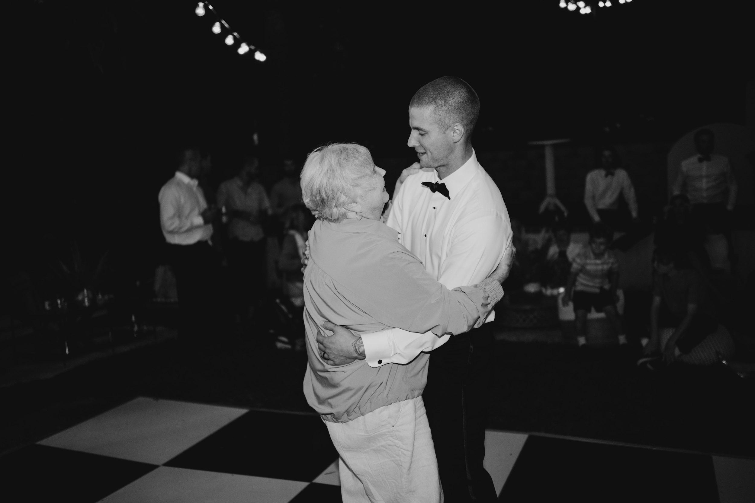 Grandma and grandson dance in Laguna Beach Backyard Wedding, image by Fatima Elreda Photo