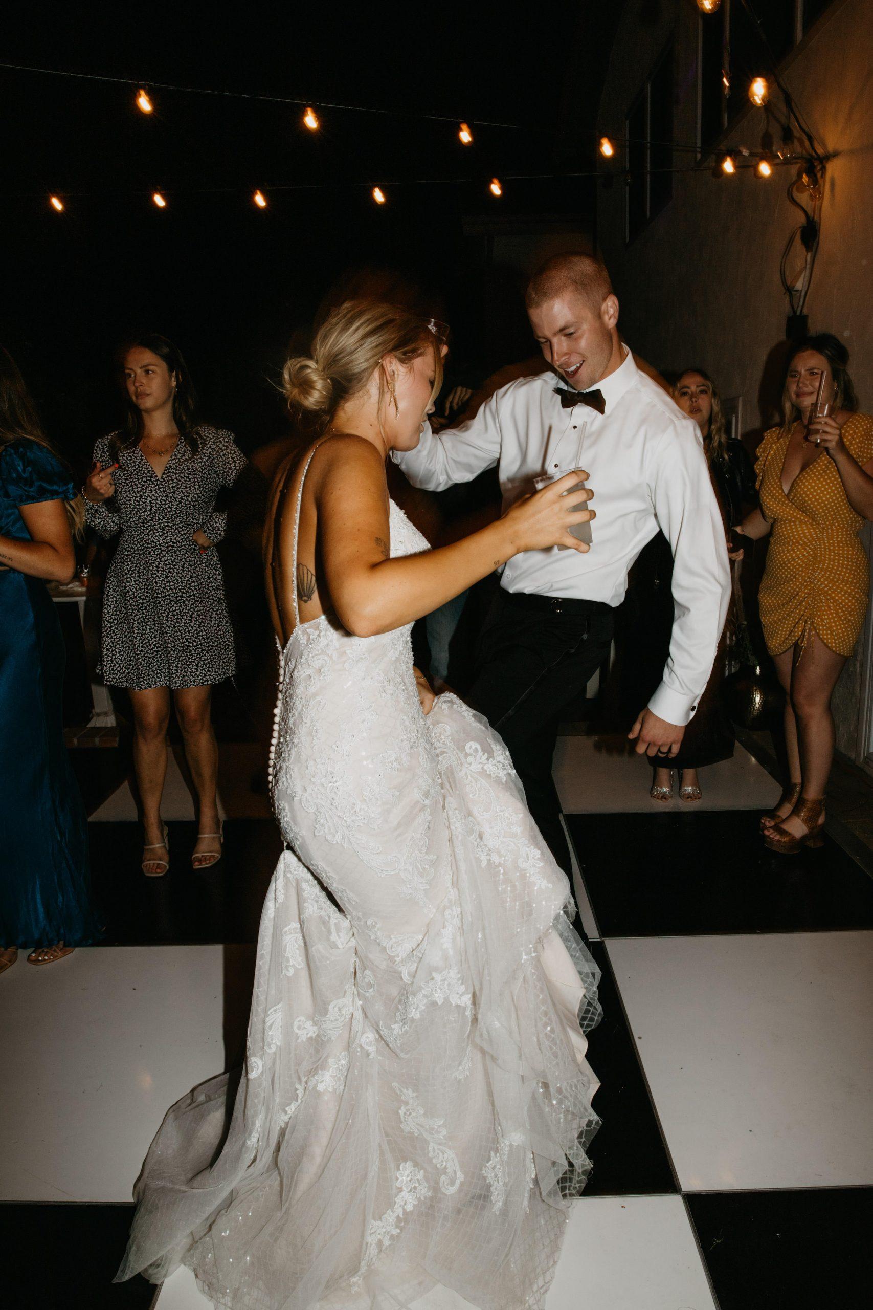 Bride and groom dancing in Laguna Beach Backyard Wedding, image by Fatima Elreda Photo