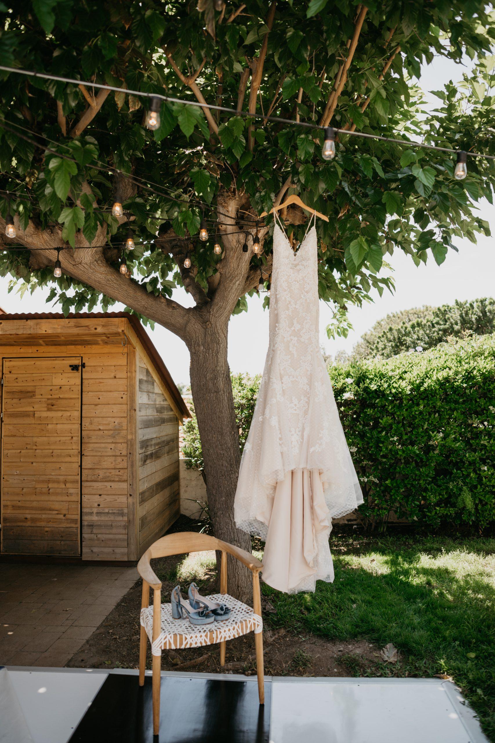 Wedding Dress and blue wedding heels in Laguna Beach Backyard Wedding, image by Fatima Elreda Photo