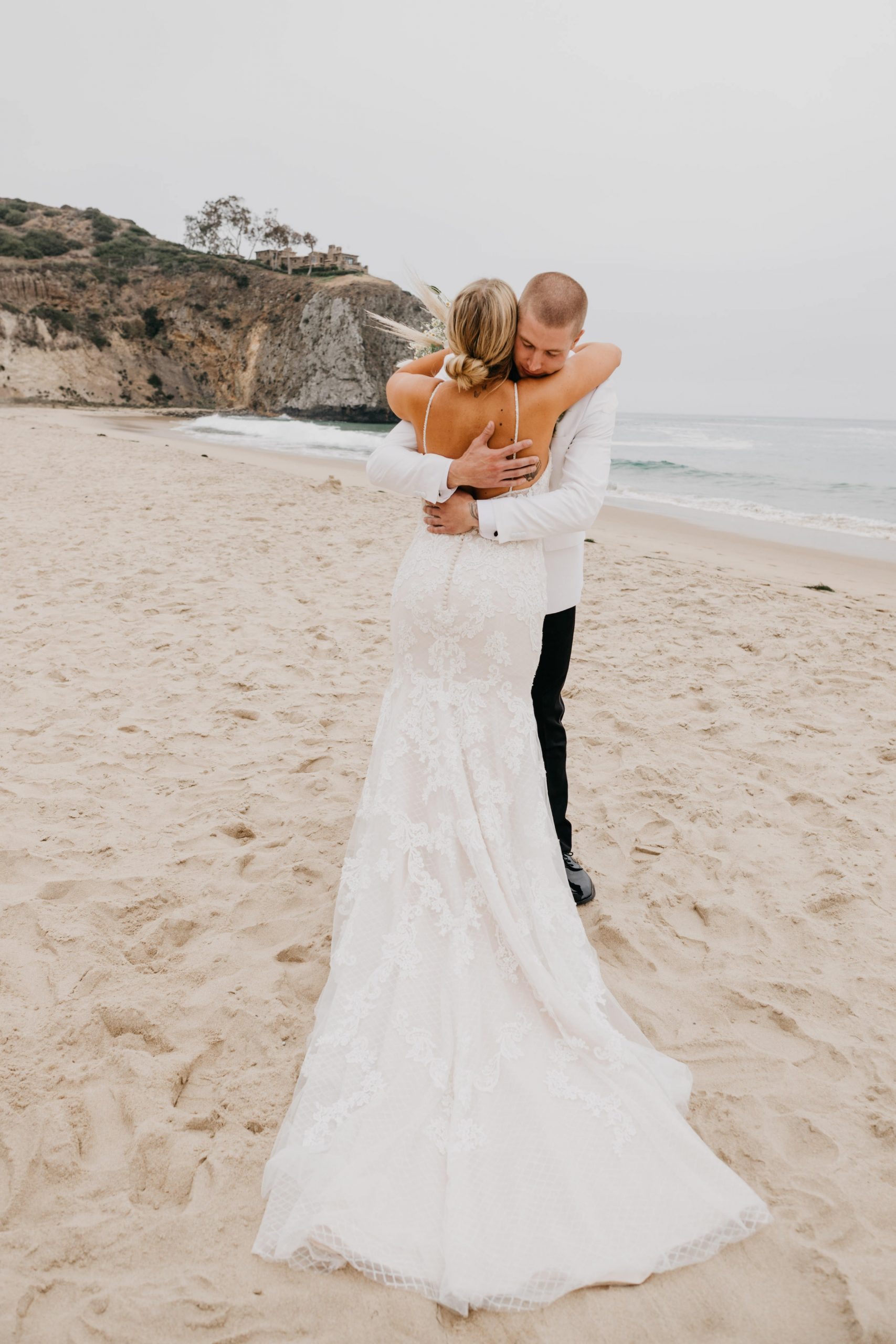 Bride and Groom First Look in Crystal Cove State park Wedding in Laguna Beach, image by Fatima Elreda Photo