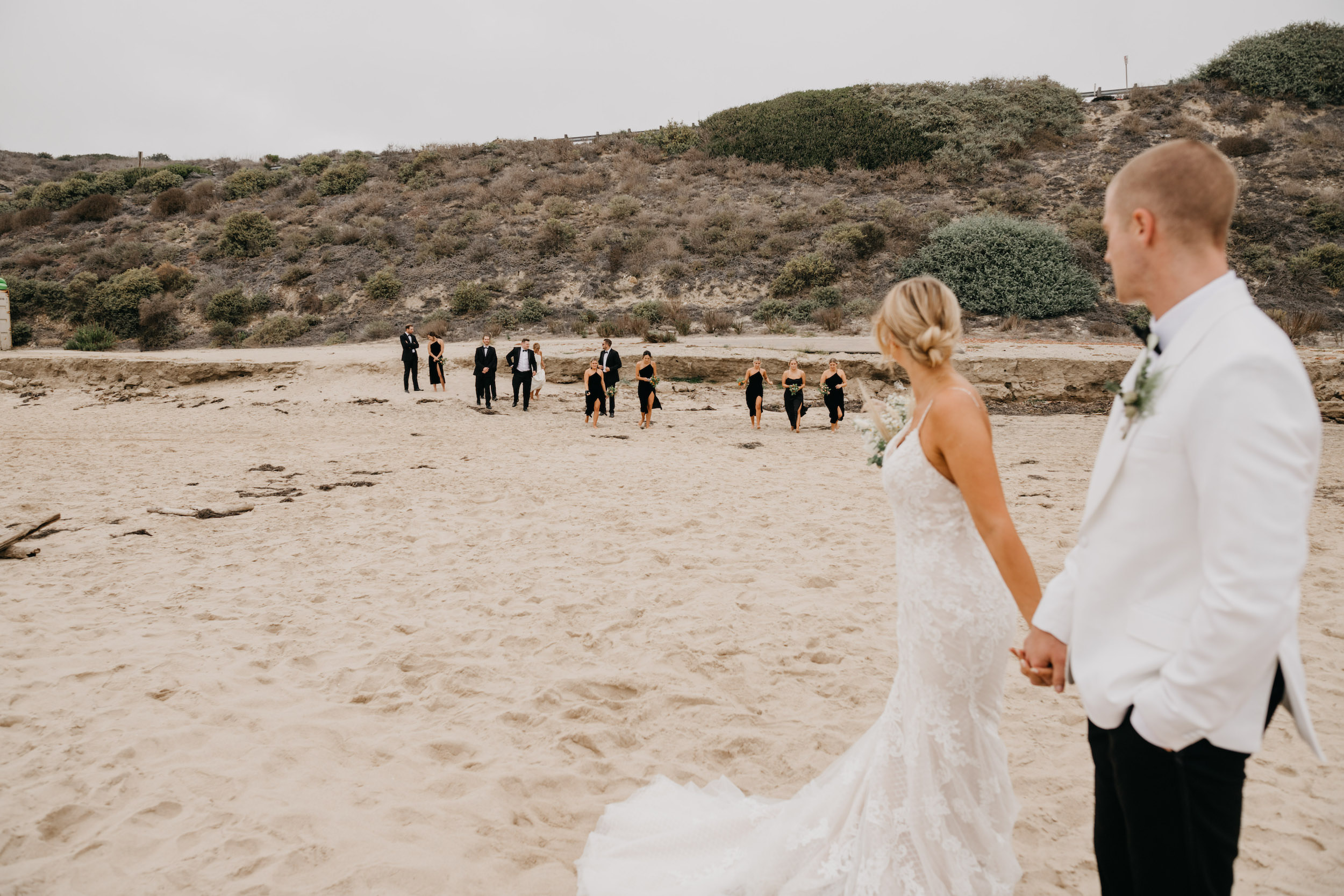 Bride and groom and bridal party in Crystal Cove State Park Wedding in Laguna Beach, image by Fatima Elreda Photo