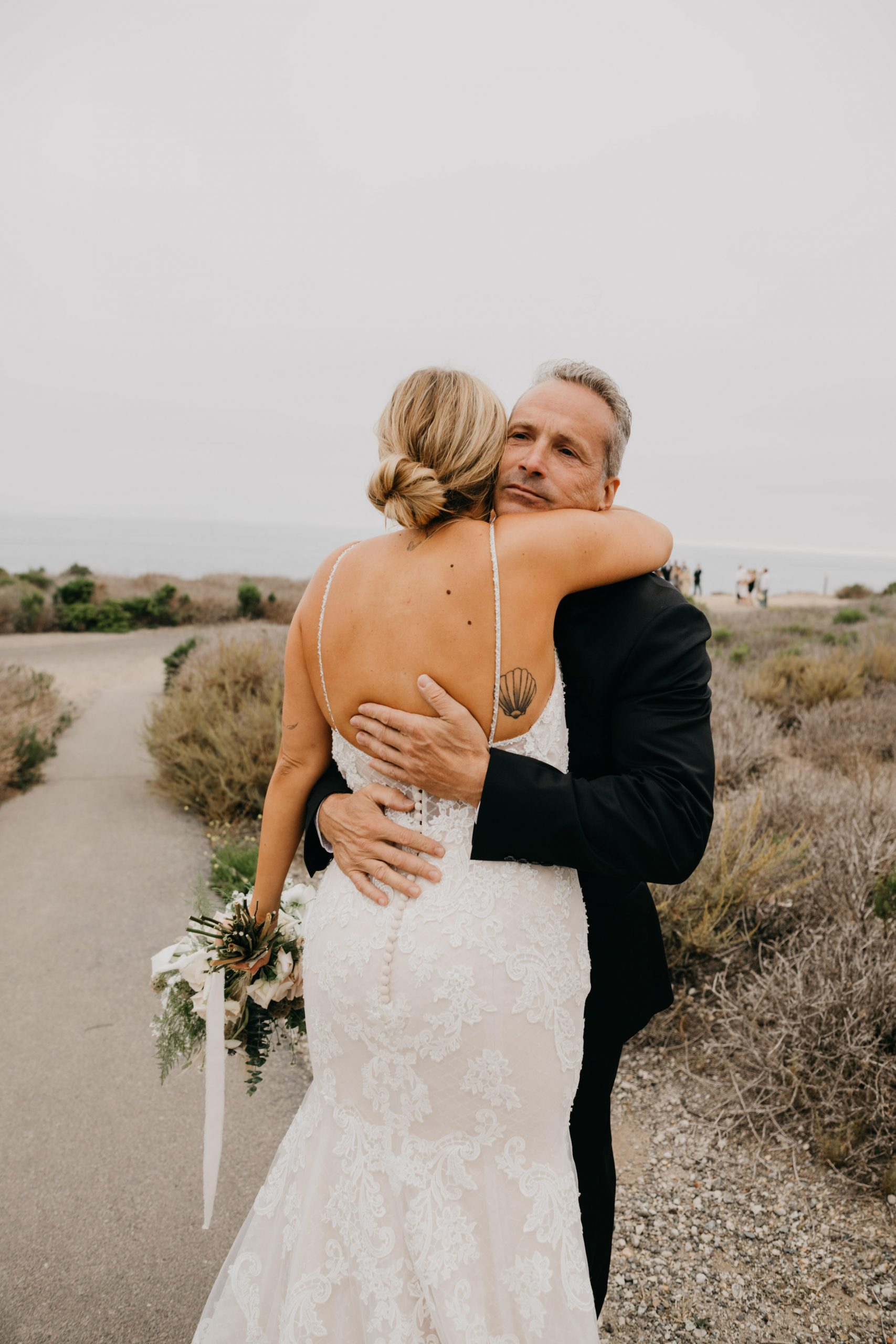 Father daughter first look in Crystal Cove State Park Wedding in Laguna beach, image by Fatima Elreda Photo