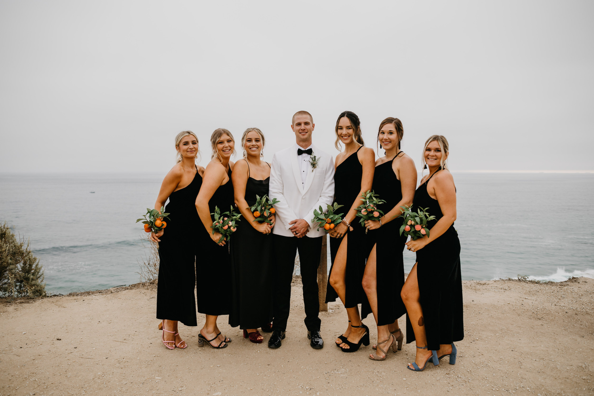 Groom and bridesmaids in Crystal Cove State Park Wedding in Laguna Beach, image by Fatima Elreda Photo