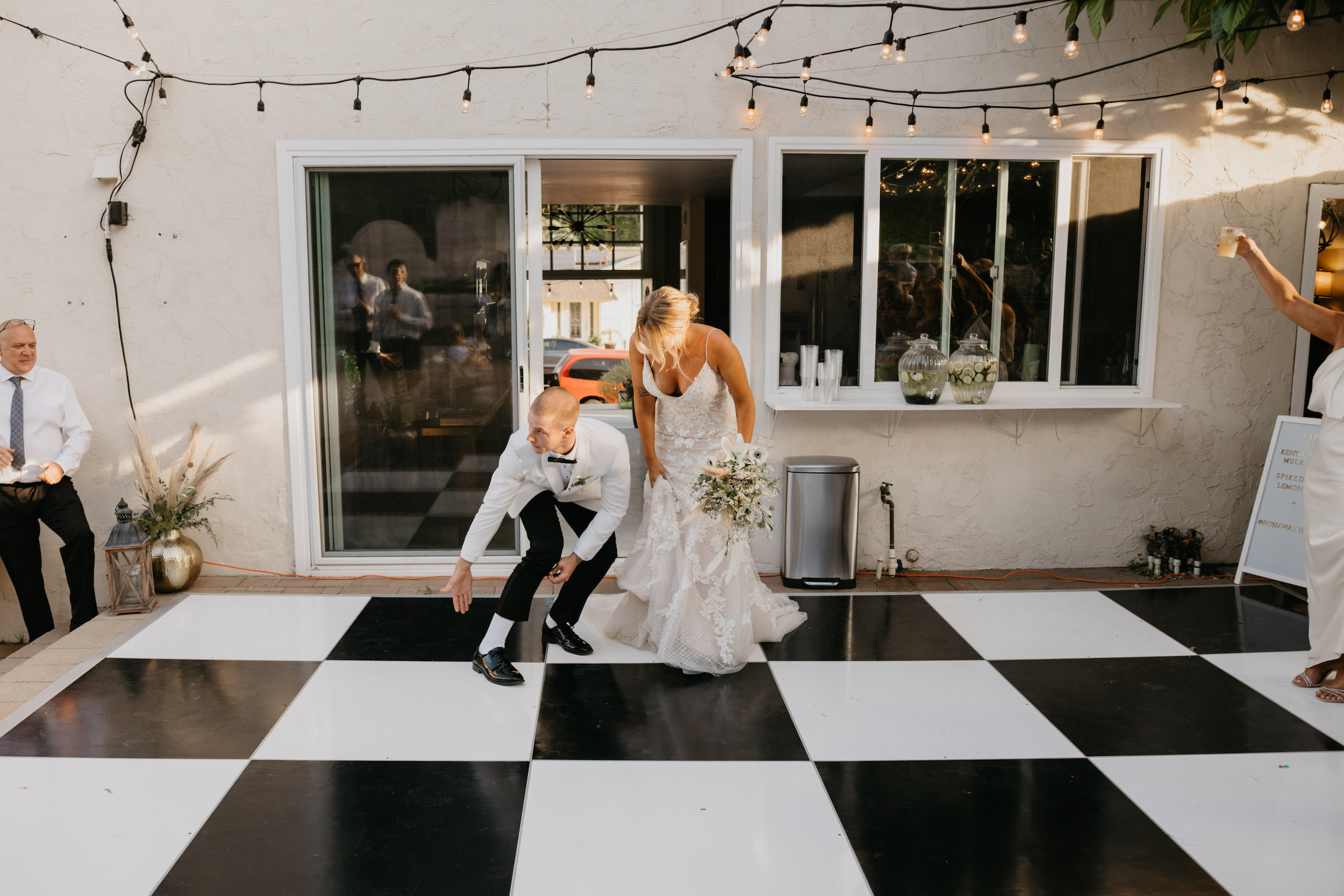 Bride and Groom grand entrance in Laguna Beach Backyard Wedding, image by Fatima Elreda Photo