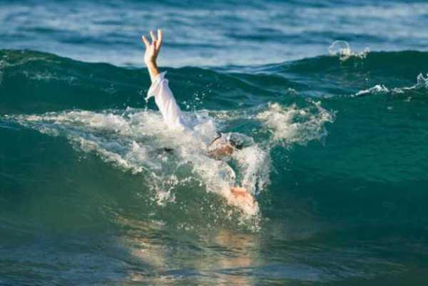 Businessman Drowning in Ocean