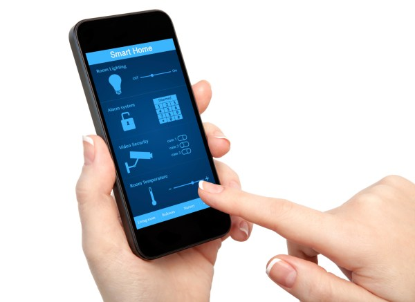 woman hand holding the phone with system smart house
