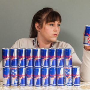 Mary Allwood, 26, from Brixham, Devon, who used to be massively addicted to Redbull and would drink 20 cans a day. See SWNS story SWBULL; A Red Bull addict ditched her 20 can a DAY habit after her liver was so damaged by the sugar doctors thought she was an alcoholic. Mary Allwood, 26, was necking so many of the energy drinks she was consuming the equivalent of up to 15 Mars bars and 16 cups of coffee every single day. The mum-of-one would stash the cans all over the house and search daily for the best supermarket price deals, forking out more than £2,300 a year on the drinks. But she was forced to face her addiction when she was admitted to hospital with pain, and an MRI scan revealed her liver was TWICE the normal size. Worried doctors were convinced she was an alcoholic until Mary confessed to her Red Bull addiction.