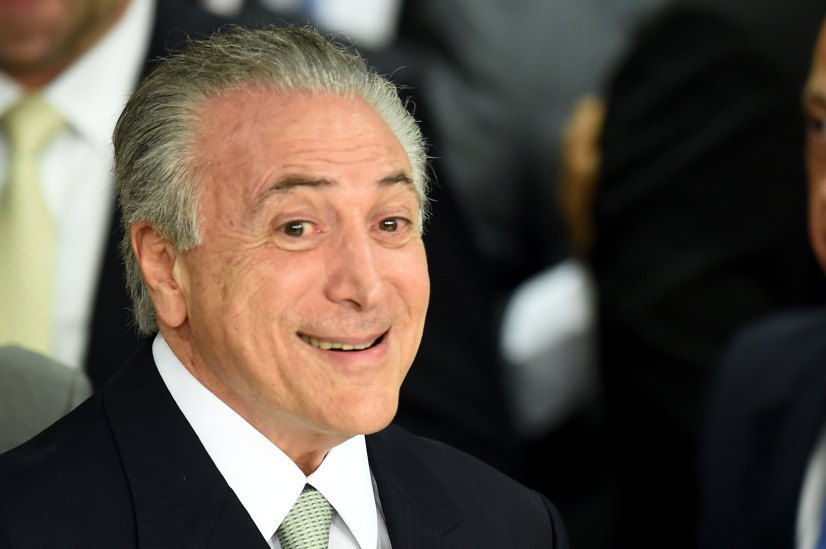 """CORRECTION - Brazilian acting President Michel Temer (R) gestures during the inauguration ceremony of the new ministers at Planalto Palace, in Brasilia, on May 12, 2016. Brazilian President Dilma Rousseff was suspended Thursday to face an impeachment trial, ceding power to her vice president-turned-enemy Michel Temer, who quickly pivoted toward a more business-friendly government, naming a cabinet chosen to calm the markets after a paralyzing impeachment battle and steer the country out of its worst recession in decades. / AFP PHOTO / EVARISTO SA / """"The erroneous mention[s] appearing in the metadata of this photo by MARCOS CORREA has been modified in AFP systems in the following manner: [EVARISOT SA] instead of [MARCOS CORREA] on byline. And Source AFP instead of BRAZILIAN VICE PRESIDENCY. Please immediately remove the erroneous mention[s] from all your online services and delete it (them) from your servers. If you have been authorized by AFP to distribute it (them) to third parties, please ensure that the same actions are carried out by them. Failure to promptly comply with these instructions will entail liability on your part for any continued or post notification usage. Therefore we thank you very much for all your attention and prompt action. We are sorry for the inconvenience this notification may cause and remain at your disposal for any further information you may require."""""""