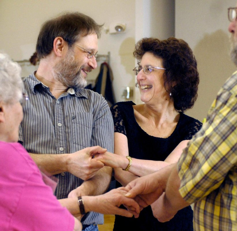 Heather Coit/The News-Gazette FOR FEATURES- Mitch and Frances Harris join another couple during contra dancing at Phillips Recreation Center in Urbana, Ill on Friday, May 16, 2008.