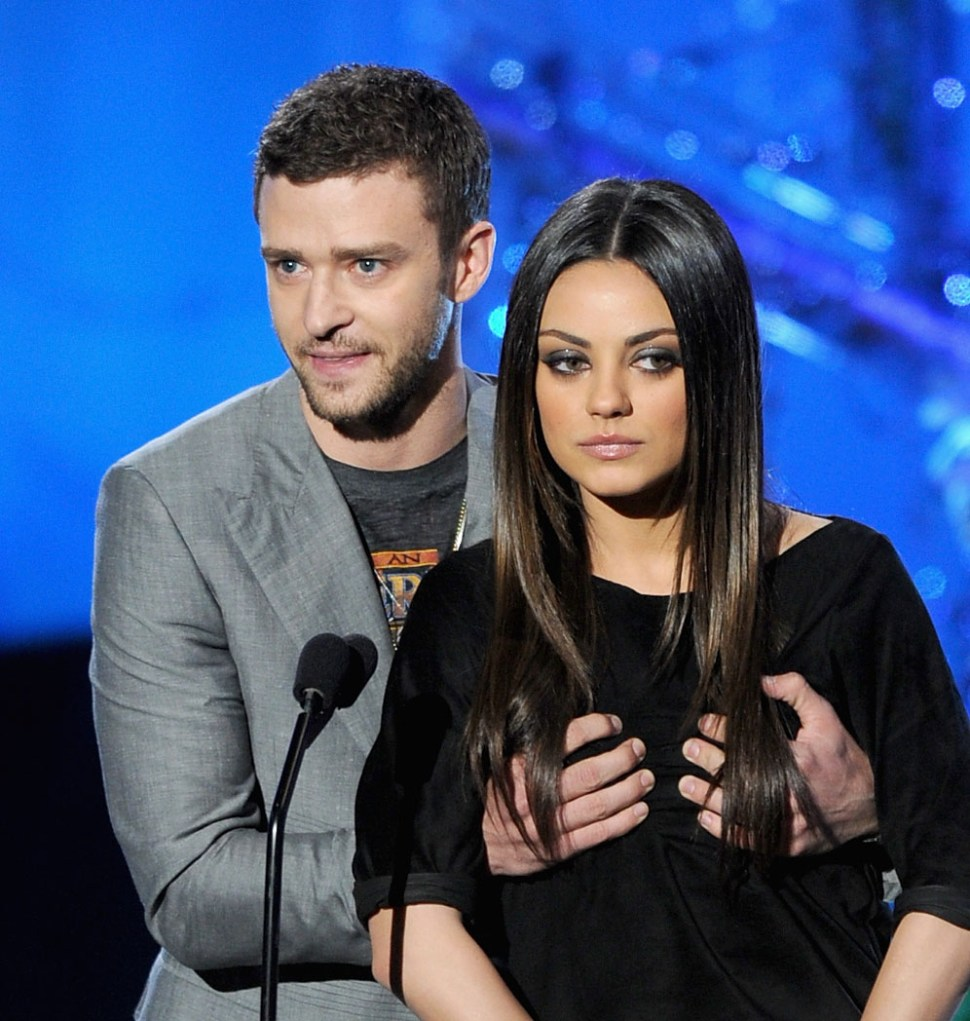 UNIVERSAL CITY, CA - JUNE 05: Actors Justin Timberlake (L) and Mila Kunis present an award onstage during the 2011 MTV Movie Awards at Universal Studios' Gibson Amphitheatre on June 5, 2011 in Universal City, California. (Photo by Kevin Winter/Getty Images)