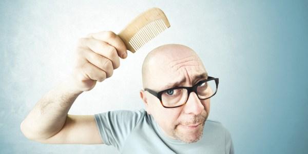 nostalgic man comb his bald head
