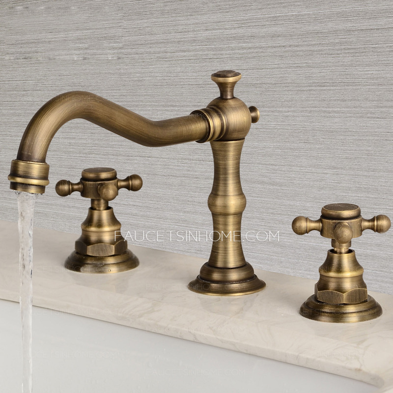 https www faucetsinhome com vintage antique brass three hole cross handle bathroom faucet p 381 html currency aud