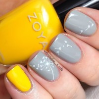 Grey & yellow nails with dandelion design - FaveThing.com