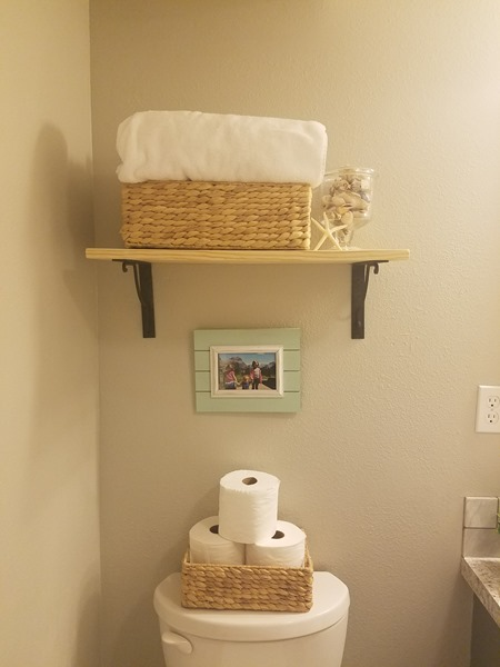 Girls bathroom shelving above toilet
