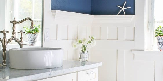 White-marble-and-navy-blue-bathroom-with-board-and-batten-wainscotting.jpg