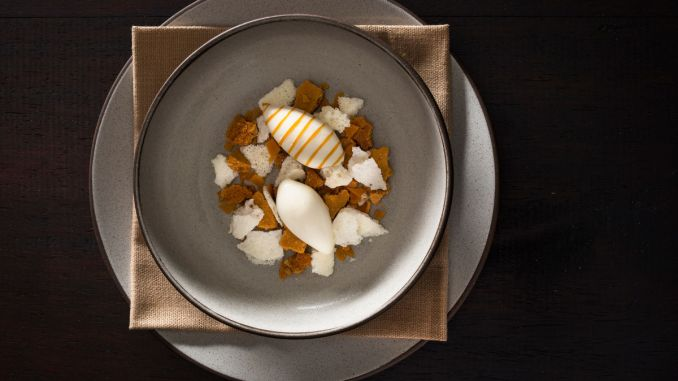 A dessert of honey oatmeal crumble with honey brittle, dehydrated milk foam, and ice milk drizzled with honey prepared by NoMad Executive Pastry Chef Mark Welker