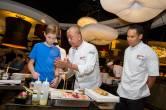"Chef Nobu Matsuhisa teaches his newest protégé his ""Nobu Style"" sushi making techniques. Credit Erik Kabik"