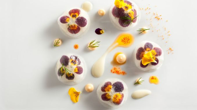 Peekytoe Crab with Pickled Daikon Radish and Violas prepared by Daniel Humm, Executive Chef of Eleven Madison Park in NYC.
