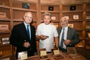 Chefs Guy Savoy and Gordon Ramsay pose with Caesars Palace Regional President, Gary Selesner, at Montecristo Cigar Bar.