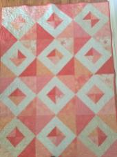 This is a large baby quilt made for a very special baby girl.