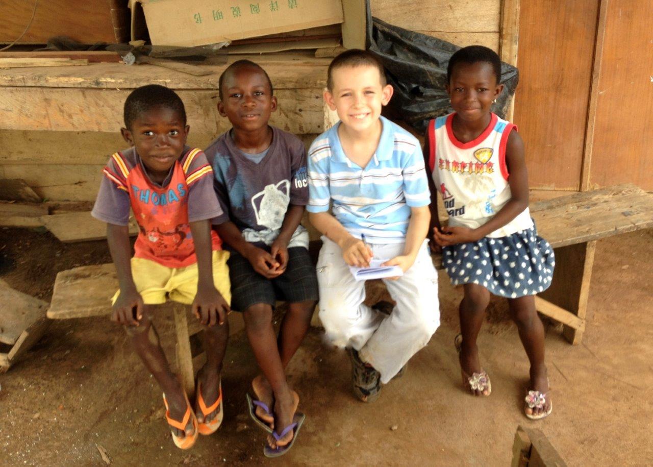 John Sarver Sharing the Gospel with Several Ghanaian Children