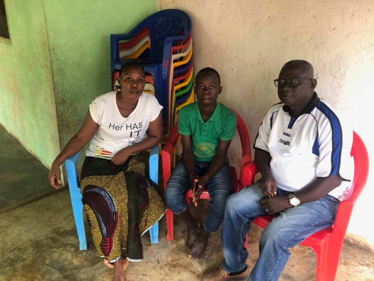 Pastor with a widow and son