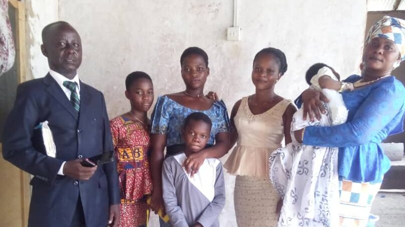 Pastor with converts