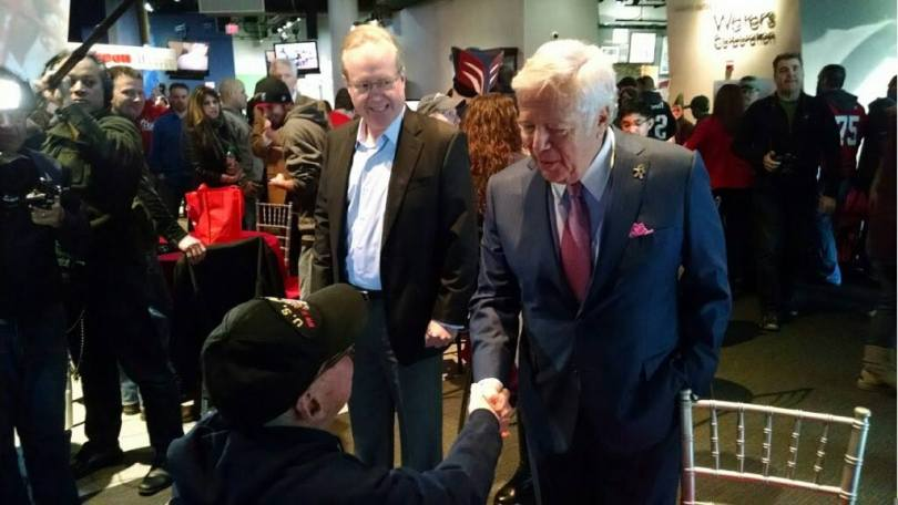 New England Patriots Chairman and CEO Robert Kraft, President Jonathan Kraft, players and cheerleaders joined veterans and active duty military members to unfurl three American flags on the field in a pre-game ceremony honoring military at Gillette Stadium on Sunday, Nov. 23.