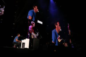 Courtesy of Gillette Stadium / David Silverman Coldplay front man, Chris Martin (left), performs at Gillette Stadium on Sept. 25, 2015 with Ed Sheeran. Saturday's concert will be Coldplay's first ever performance in Foxborough.
