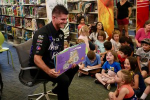 Bryce Kenny, Monster Jam driver of Mohawk Warrior, reads to children at Foxborough's Boyden Library on Friday, June 8 – the day before he and 13 other drivers competed in the 2018 Monster Jam at Gillette Stadium.
