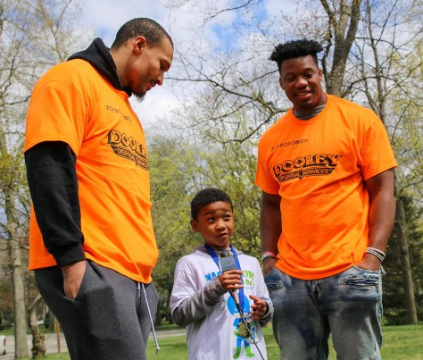 Jaden Onwuakor (center) interviews Patriots defensive linemen Derek Rivers (left) and Keionta Davis (right) at the seventh annual Clean Up Foxboro Day on Saturday, April 27.
