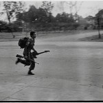 On the morning of the 17th, a lone soldier runs on Monivong with his gun and his guitar.