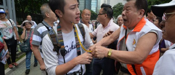 HKFP's Stanley Leung is surrounded by protesters at the Legco rally. Photo: HKFP