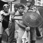 Police arrest some union members during a raid outside a plastic flower factory in San Po Kong. 12MAY67. Byline: Chan Kiu Credit: SCMP