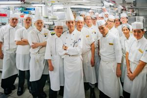 George with his hard-working team in the club's newly refurbished kitchen.