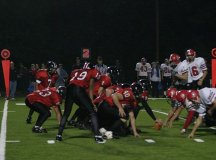 The Mustangs wrap up a Madison County ball carrier last Friday night (Photo: Bob Morrison, Bonnie Briar Productions LLC)