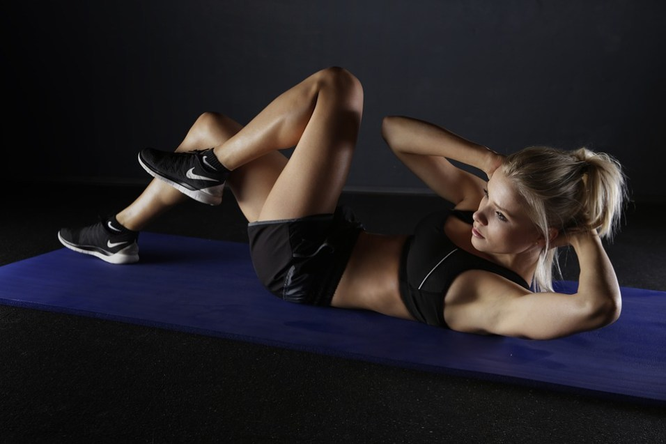 Woman working out her abs