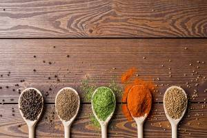 Spoon of full different spices