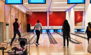 a group of people playing bowling