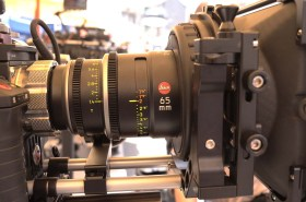 """New Leica Summilux-C 65 mm Prime at Band Pro booth. Note close-focus marks (1'6"""" -2"""" 'in orange)."""