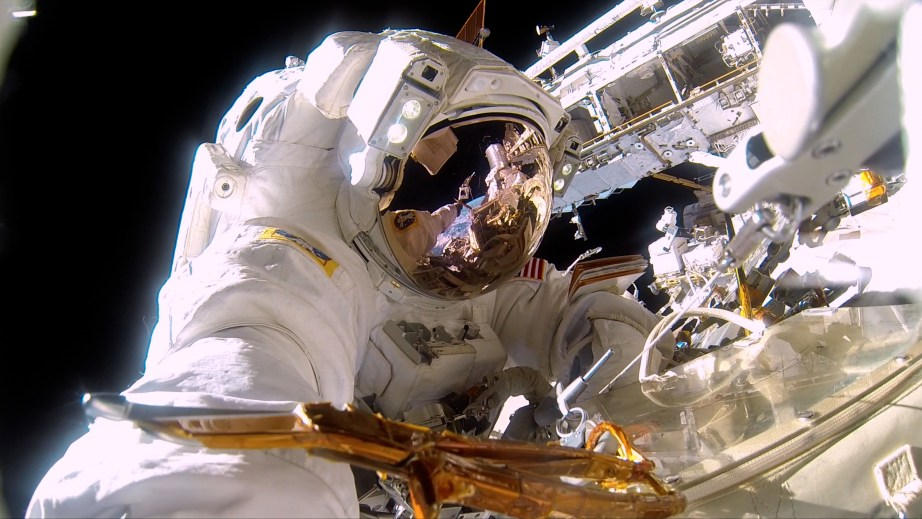 At left: NASA Commander Barry (Butch) Willmore on a spacewalk to repair the exterior of the International Space Station. It's almost 300° on the sun side of the space station and -275° in the shade. Photo courtesy of NASA.