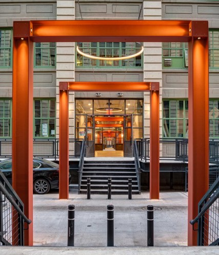 Building entrances are connected visually by orange steel rectangles