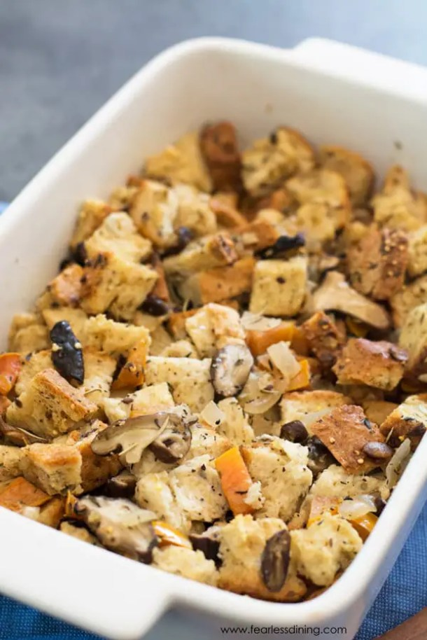 A white baking dish filled with gluten free mushroom stuffing