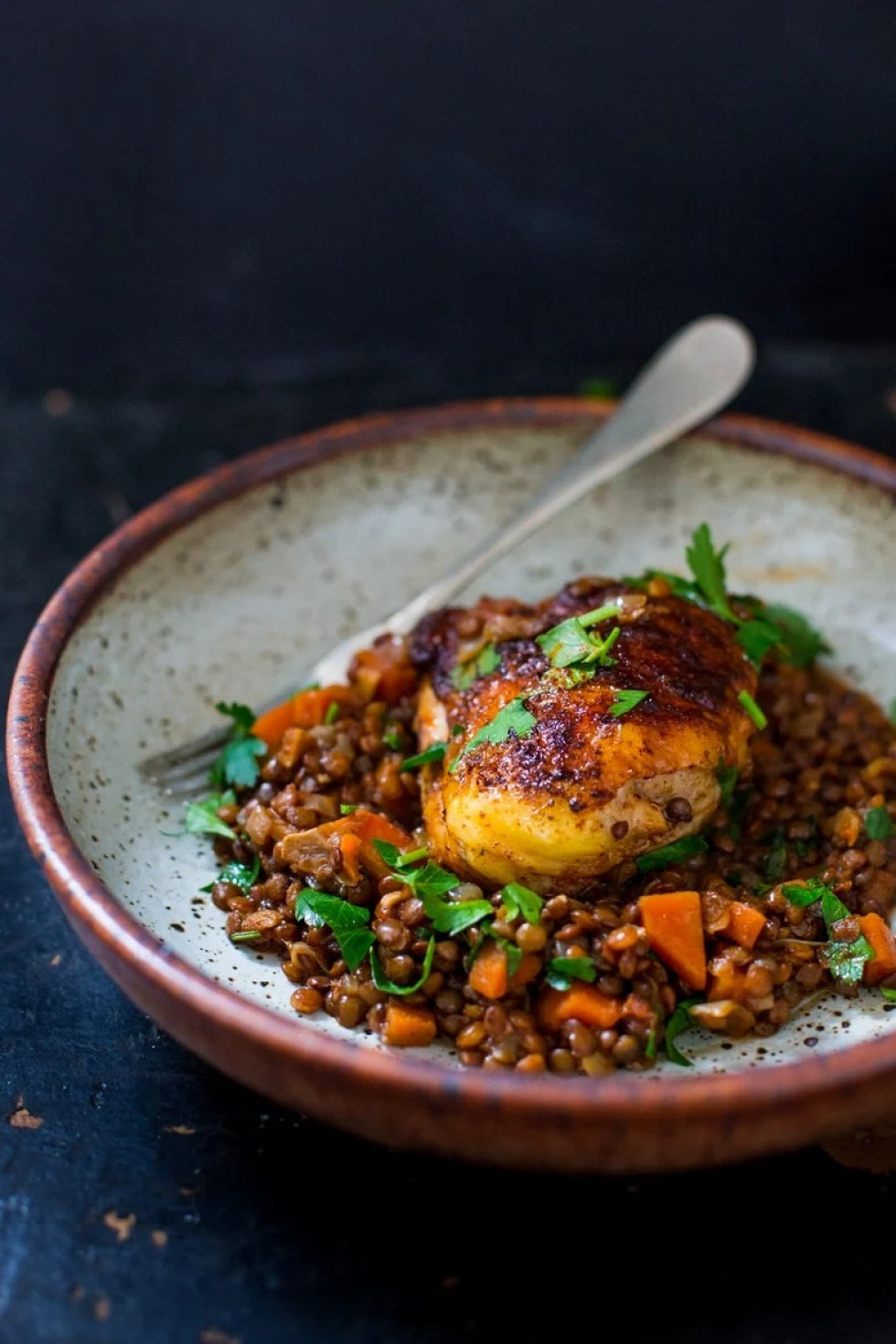 A deliciously flavorful recipe for Berbere Chicken over Ethiopian spiced Lentils with an easy recipe for Berbere Spice Blend.   www.feastingathome.com