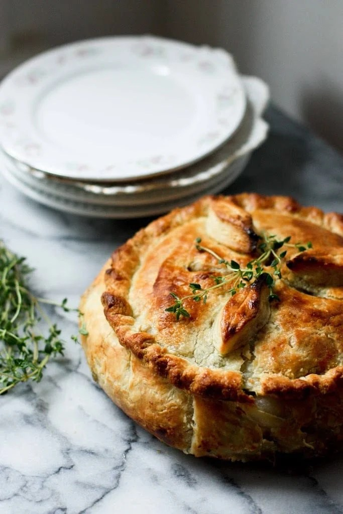 A vegan Spring Pot Pie bridges the seasons by utilizing the new vegetables of Spring, in a warm and comforting way. Easy and adaptable | www.feastingathome.com