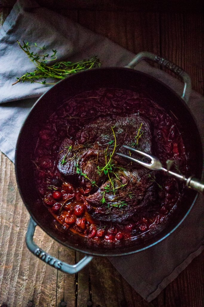A simple delicious recipe for Cranberry Pot Roast, that makes the whole house smell good....serve with horseradish mashed potatoes.| www.feastingathome.com
