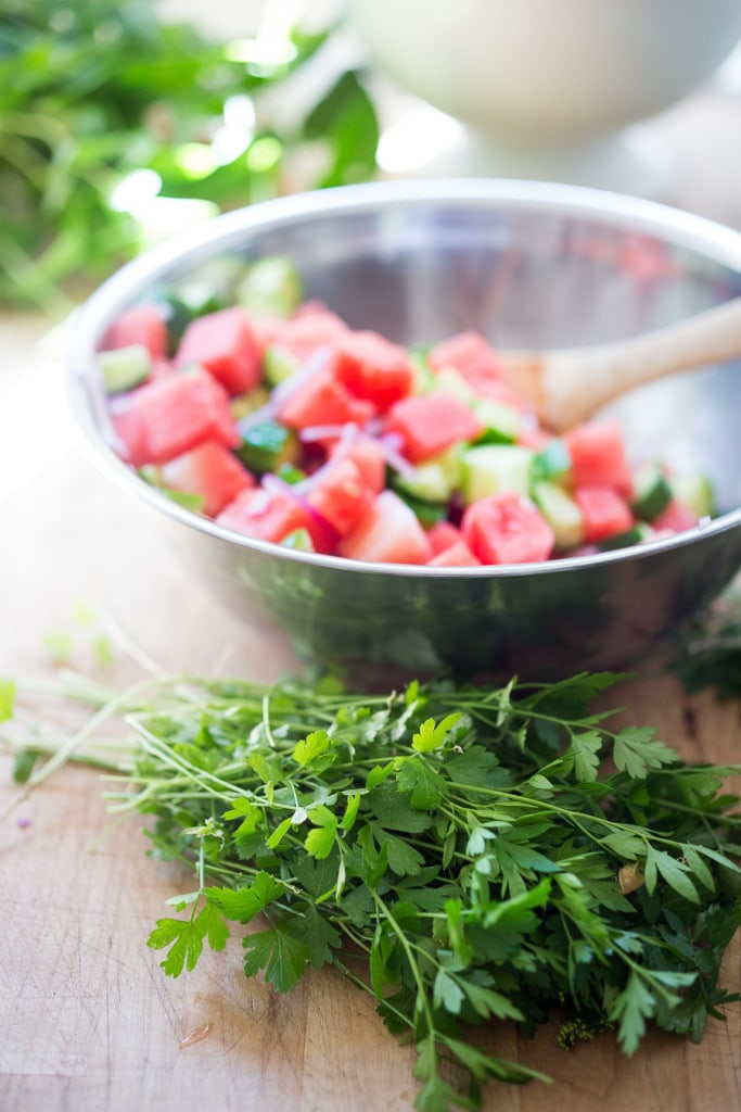 A Moroccan Watermelon Salad with Cucumber, pistachios, parsley, mint, onion and  crumbled feta...refreshing, simple and delicious!   www.feastingathome.com